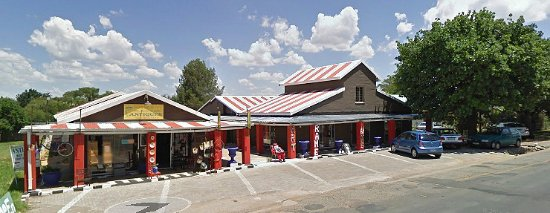 Just look for us in the building with the many red pillars. We are in the main street of Parys.
