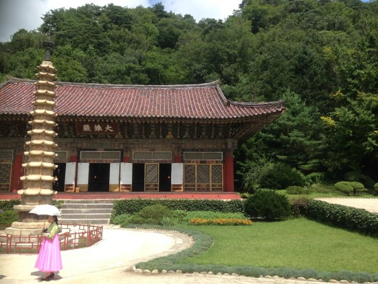 Hyangsan, North Korea: A miniature pagoda and a guide in traditional Korean dress.