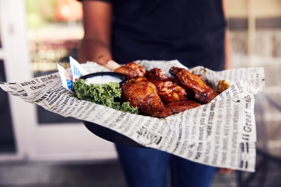 Big Whiskey's American Restaurant & Bar: 60 cent bone in wings, Sunday's only