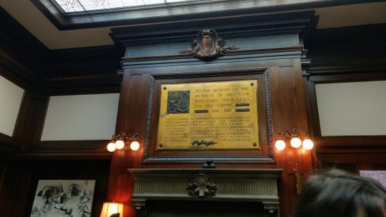 Union Club British Columbia : A photo fo the WWI memorial above the fireplace in the dining room