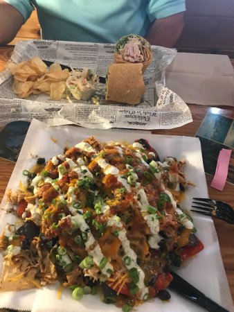 Yellow Dog Eats Kitchen & Bar: Pulled Pork Nacho plate in the front & Hot Diggity Dawg is the roll