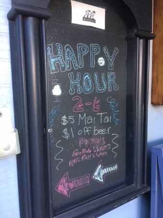 808 Bistro: Happy Hour board visible from sidewalk in complex
