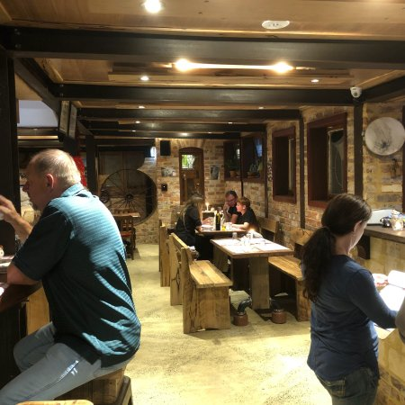 Quaint cellar pizza restaurant with stuffed breads and charred meats thin crust real wood fired