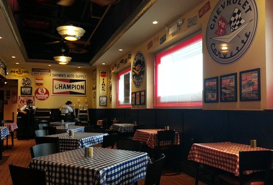 Harwood Heights, IL: side room that's themed in automotive memorabilia