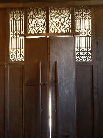 Windows And Doors Are Traditional And Locked With Wooden Slats