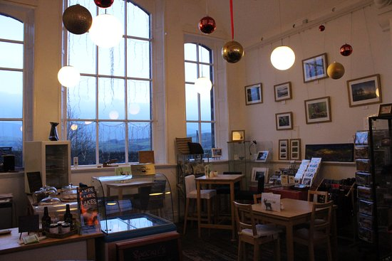 Uldale, UK: Just one side of this spacious tea room, with local artwork on the walls
