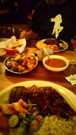 """F. McLintocks Saloon & Dining House: combo and steak with all the """"family style"""" sides"""