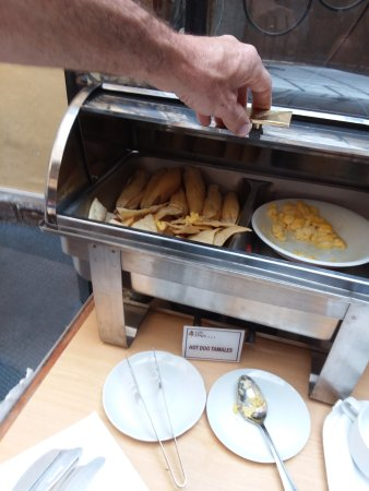 Los Apus Hotel & Mirador: Little Masa Tamales with a single Raisin inside? Eggs And hot dog slices are in there too.