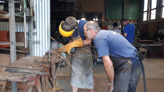 Wakefield, New Zealand: Using the grinder to shape the blade