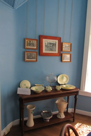 Independence, MO: Pictures hanging from long string / ribbon so as not to crack the lath and plaster walls.