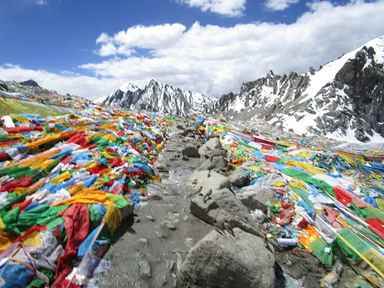 Lhasa, China: Buddhist Prayer flags on the top of mountain pass. Dolma La pass 5600 miters in kailash Parikram
