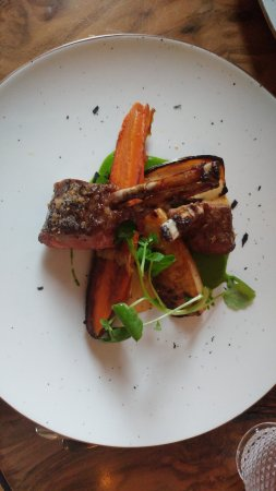 Rack of Lamb with leeks, pickled shallots, carrots, baked celeriac, mustard sauce