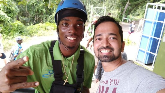 akward zipline operator and me feeling amazing after the ride