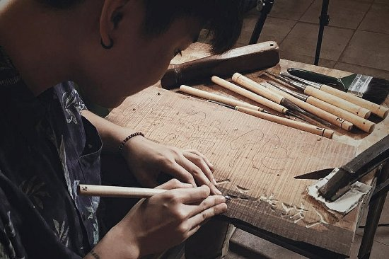 Batu Pahat, Malaysia: Wood carving using the traditional technique - is an Art. This helps to train one's patient in w