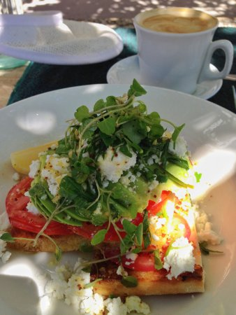 Peregian Beach, Australia: Turkish Toast with Tomato, avo, goats cheese and greens.
