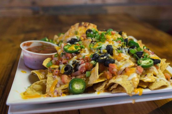 Camano Island, WA: ~Nachos!~ Layers of our house made nacho cheese sauce, topped with all sorts of goods!