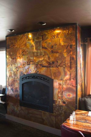 Camano Island, WA: Custom made by local company. Hand pounded copper fireplace.