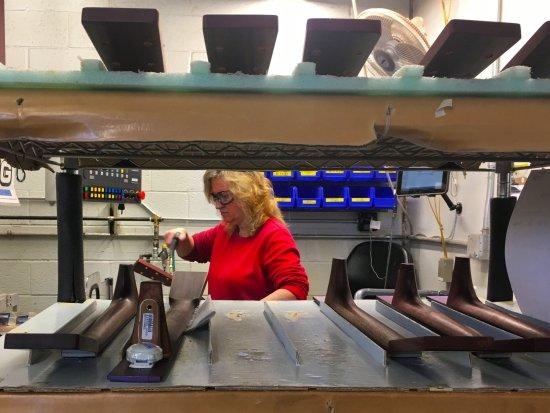 Nazareth, PA: A Martin Guitar employee works on frets
