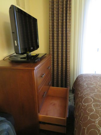 Staybridge Suites Memphis - Poplar Ave East: Dresser and foot of bed.