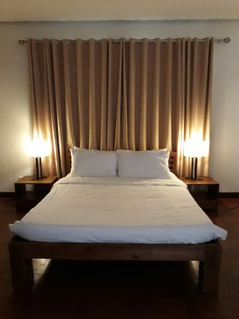 Hassaram Courtyard: Cozy queen-sized mattress in the bedroom with blackout curtains.