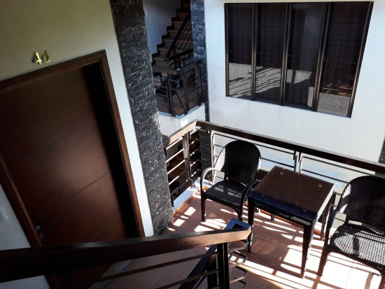Hassaram Courtyard: Room entrance with outdoor furniture at stair landing. 2BR is on the 2nd and 3rd floor.