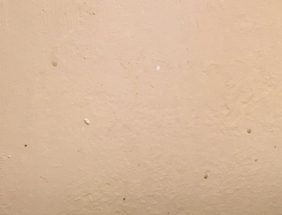 Watkins, CO: brown splatters on wall beside sink