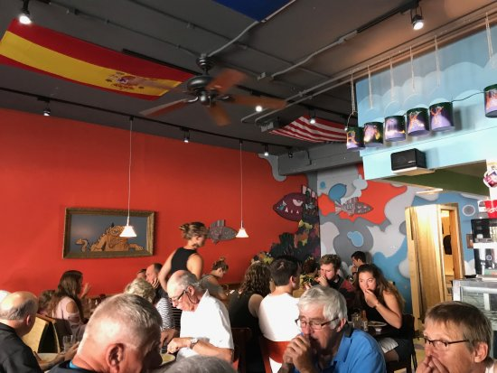 Rocky Bay Cafe: Inside the busy restaurant, I love the designs on the walls