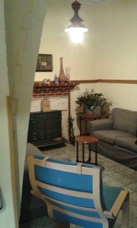 Benitachell, Spain: salón con chimenea