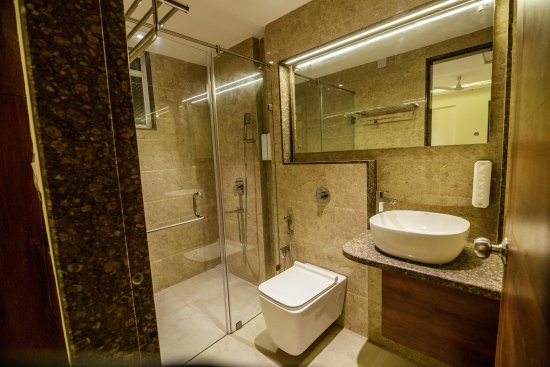 Well appointed bathrooms with demarcated dry and wet areas - Picture on wet wall design, wet floor design, water heater design, refrigerator design, painting design, kitchen design, small shower room design, wet playground design, small toilet room design, disability home design, wet sauna design, wet spa design, wet kitchen,