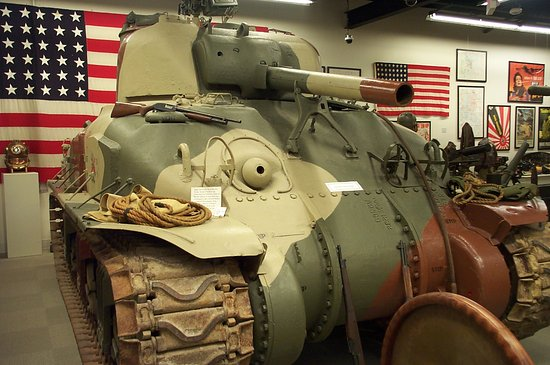 Sherman Tank, painted in desert camo, from America enters