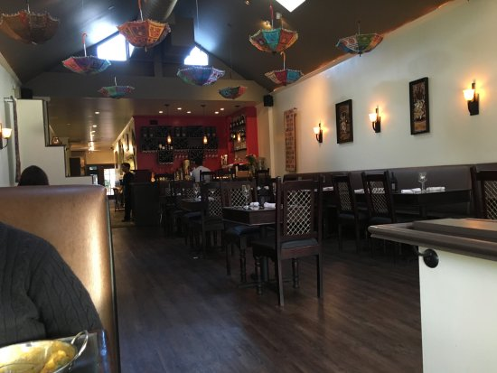 Delhi Belly Indian Bistro Restaurant Decor Simple Clean With Upturned Umbrellas