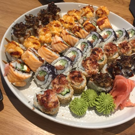 Sushi Panda: Really delicious sushi, here on a plate the Grilled mix set and Valencia rolls together, we enjo