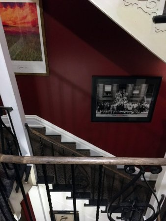 """Tabard Inn: Staircase from suite to lobby. PHOTO; Art Kane's iconic """"Jazz Portrait"""" 1958, Harlem, NYC."""
