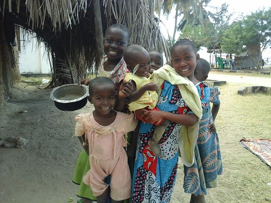 Lindi Region, Tanzania: Another warm greeting from village welcoming committee as we walked to the beach each day.