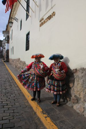 Locals just outside the Belmond Hotel Monasterio main entrance
