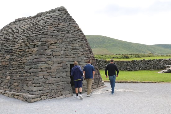 """Gallarus Oratory: The stonework is absolutely amazing. Note that the guys range from 6 feet to 6'4""""."""