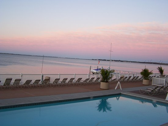 Somers Point, NJ: Looking out over pool at Pier 4 with view of bay and sunset.