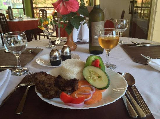 Tumaini Cottage : An authentic African dish and Tanzania wine served at Mbalamwezi restaurant