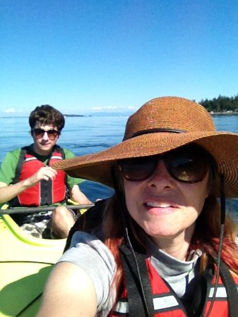 Outer Island Expeditions : My son and I in our tandem Kayak off Orcas.
