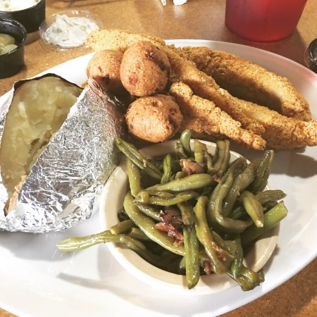 Jasper, AR: Fried catfish dinner with green beans and baked potato.