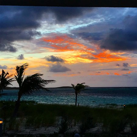 South Caicos: Just look at this sunrise from our room. Right outside the doors.