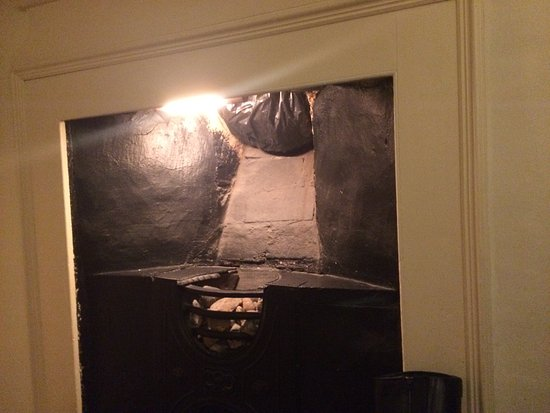 The Lion Hotel: Black rubbish bag in the chimney flue to keep out draughts? Bats?