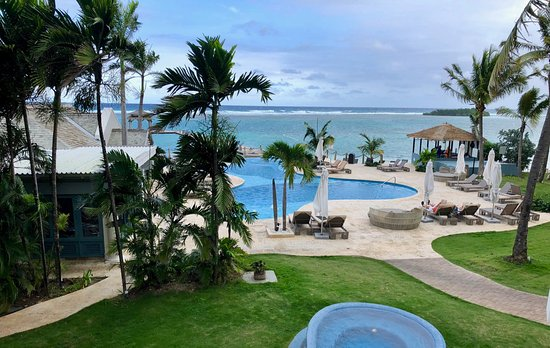 Zoetry Montego Bay Jamaica: Pool and ocean with restaurant on the left.