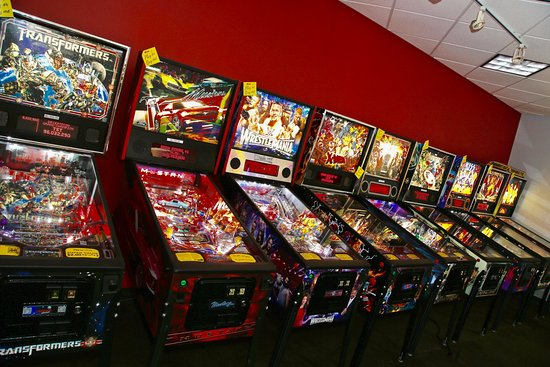 Birmingham, AL: Wall full of pinball games (there are more in the other stores too!)
