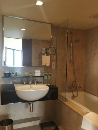 Bathtub with shower head - Picture of Royal Orchid Sheraton Hotel ...