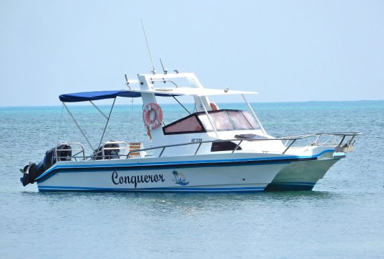 "Grand Anse, Seychellene: Our boat the ""Conqueror"", a 27 footer catamaran powered by twin Suzuki 140 Hp 4 stroke engines"