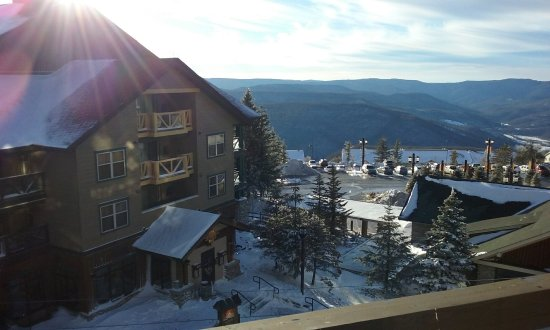 Highland House Condos: Sunset view, village, and mountains from balcony (Room 412). Other rooms nearby have similar vie