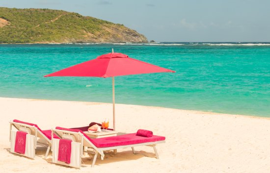 Canouan: When you get to the beach, the beach concierge primps your chairs and offers to bring you drinks