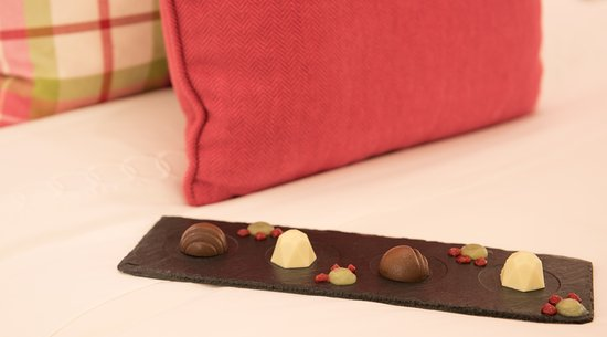 Кануан: Taking chocolates on your pillow to the next level.