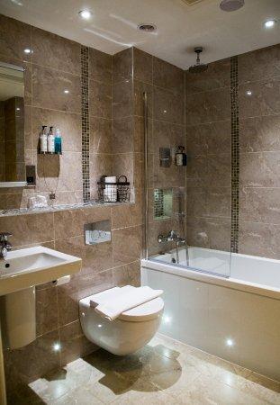 Deluxe bathrooms have new bathroom suites, mood lighting, waterfall ...